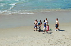 Family enjoying a walk at Thalia Beach, Laguna Beach, California. Stock Photos