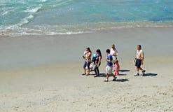 Family enjoying a walk at Thalia Beach, Laguna Beach, California. Stock Photos