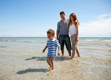 Family Enjoying the Weekend on a Sunny Beach Royalty Free Stock Photo