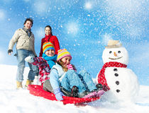 Family Enjoying Winter Day Tobogganing Concept Royalty Free Stock Images