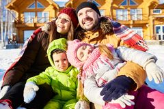 Family enjoying winter getaway stock images