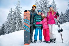 Family enjoying in winter vacations together. In mountains Stock Photo