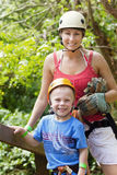 Family enjoying a Zipline Adventure on Vacation. A mother and son enjoying a zipline adventure trip while on a family vacation Royalty Free Stock Photos