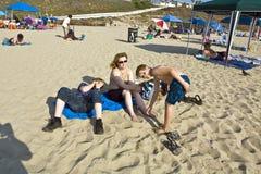 Family enjoys the beautiful beach Stock Image