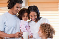 Family enjoys having breakfast together Royalty Free Stock Images