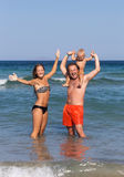 Family enjoys holiday at sea Stock Images