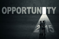 Family enter opportunity door to future 2015. Silhouette of family standing in front of opportunity door toward the future 2015 Royalty Free Stock Photos