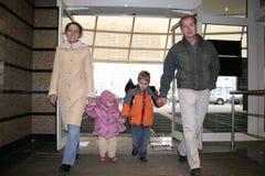 Family enter shop Stock Photos