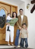 Family At The Entrance Of New House Stock Photo