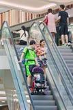 Family on escalator at Livat Shopping Mall, Beijing, China Royalty Free Stock Photo
