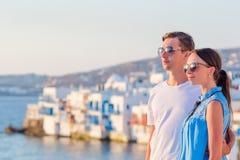 Family in Europe. Happy couple in Little Venice background on Mykonos Island, in Greece. Family having fun outdoors on Mykonos streets stock photo