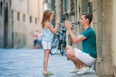 Happy father and little adorable girl in Rome during summer italian vacation stock photography