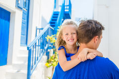 Family in Europe. Happy father and little adorable girl in Mykonos during summer greek vacation Stock Photo