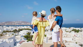 Family in Europe. Parents and kids background the old town in Mykonos island, Greece stock footage