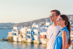 Family in Europe. Young couple on Little Venice background on Mykonos Island, in Greece. Family having fun outdoors on Mykonos streets royalty free stock photos
