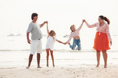 Family on the evening beach Royalty Free Stock Photo