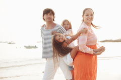 Family on the evening beach Stock Photo