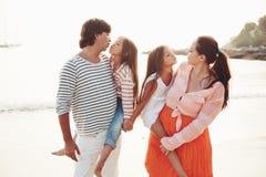 Family on the evening beach Stock Photos