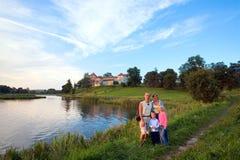 Family and evening Svirzh Castle (Ukraine). Stock Photography