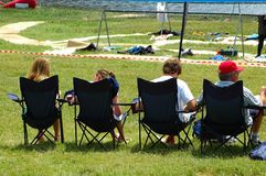 Family event. A family sitting in chairs outdoors Stock Photo