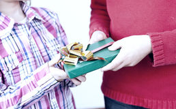 Family exchanging Christmas gifts at home Royalty Free Stock Photography