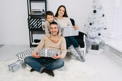 Family exchanging Christmas gifts Royalty Free Stock Photo