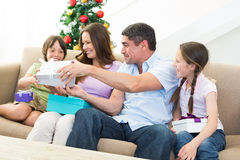 Family exchanging Christmas presents. Happy family exchanging Christmas presents at home Royalty Free Stock Images