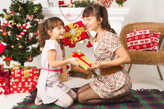 Family exchanging gifts at Christmas Royalty Free Stock Images