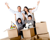 Family excited moving house Stock Images