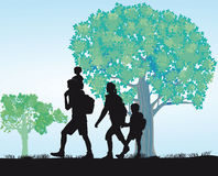 Family excursion. Illustration of a family, in black silhouette, on a walking excursion along a tree lined path Royalty Free Stock Photography