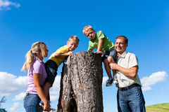 Family on excursion in summer. Happy family on excursion in summer - they discovered a trunk royalty free stock photo