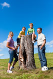 Family on excursion in summer. Happy family on excursion in summer - they discovered a trunk royalty free stock images