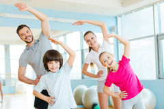 Family exercising. Royalty Free Stock Images