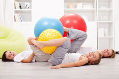 Family exercising with large gymnastic balls Stock Photos