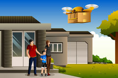 Family expecting a drone package delivery Royalty Free Stock Images