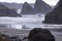 Family exploring the beach. Meyers Beach, Oregon - October 27: young family enjoying a beautiful afternoon on the Oregon coast. October 27 2016, Meyers Beach Stock Image