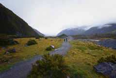 A family exploring landscape surrounding Mount Cook National Park. Royalty Free Stock Photography
