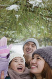 Family exploring in park in winter Stock Photo