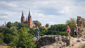 Family is exploring Rezekne castle ruins. royalty free stock photos