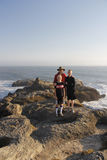 Family exploring tide pools on coast Stock Photography