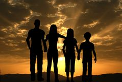 Family. Facing to the sunrise against a red sky Royalty Free Stock Image