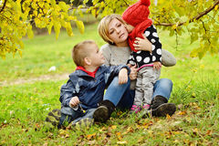 Family on fall meadow Royalty Free Stock Images