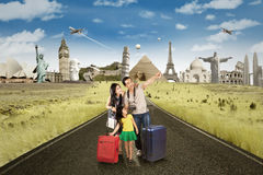 Family with famous landmarks on the road Stock Photos