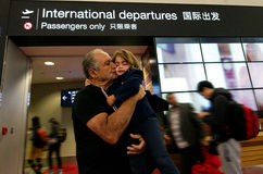 Family farewell in the airport. Grandfather farewell from his grandchild in the airport Royalty Free Stock Photo