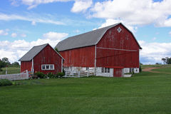 Family Farm. Red barn and shed on a family dairy farm Stock Photography
