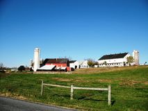 Family Farm. Landscape photograph of a traditional U.S. family farm with red barn and silo Stock Image