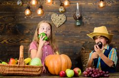 Family farm. Children presenting farm harvest wooden background. Siblings having fun. Farm market. Farming teaches kids. Where their food comes from. Kids