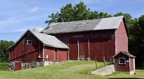 Family Farm. This is a Summer picture of the A.F. Megan Family Farm barn complex located in Cascade, Wisconsin in Sheboygan County.  This red barn complex Stock Photography