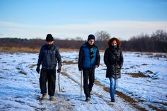 Family of farmers having a walk in a winter day Royalty Free Stock Images