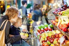 Family at farmers market royalty free stock photos
